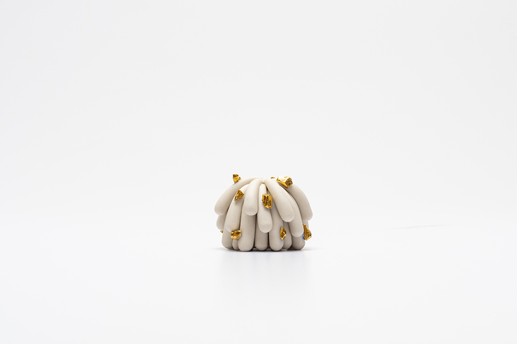 Linda Lopez - Tinniest Porcelain Dust Furry with gold rocks